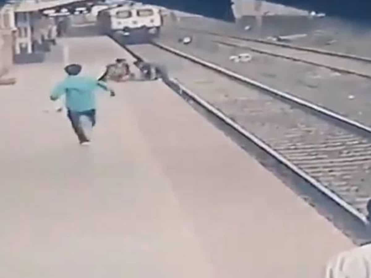Man 'out-races' speeding train to save kid