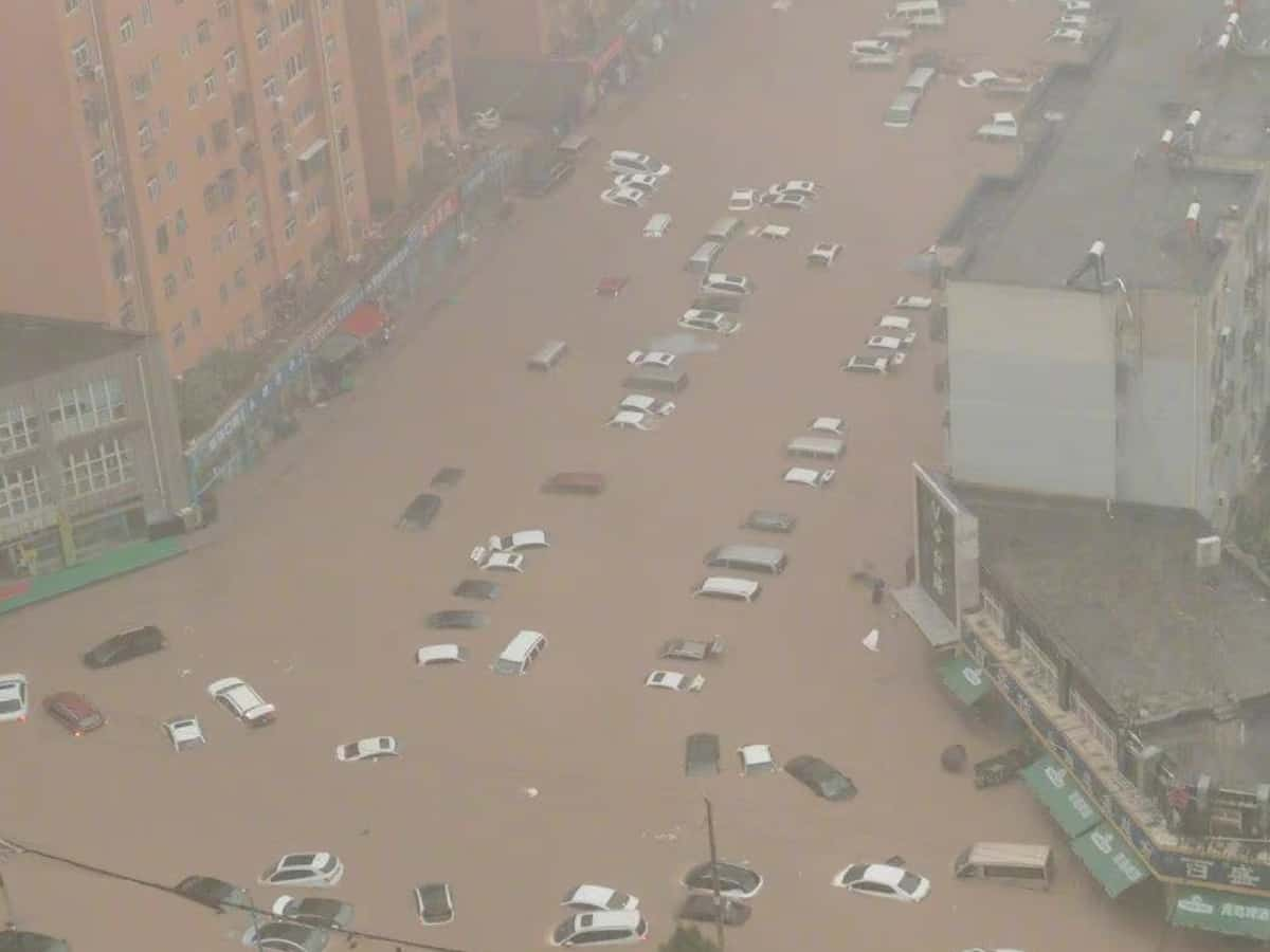 Flooding in central China turns streets to rivers